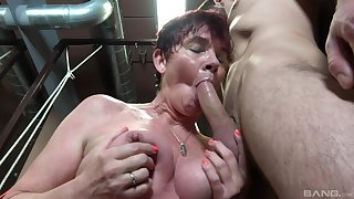 Dirty grown-up Marfeta drops on her knees to close by a blowjob all over the kitchen