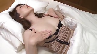 Older Asian lady is part demure dame and part horny sex kitten