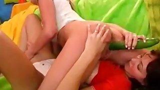 Lesbians using cucumber and dildo
