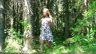 Unskilful skinny young chick squats down and pisses in the forest
